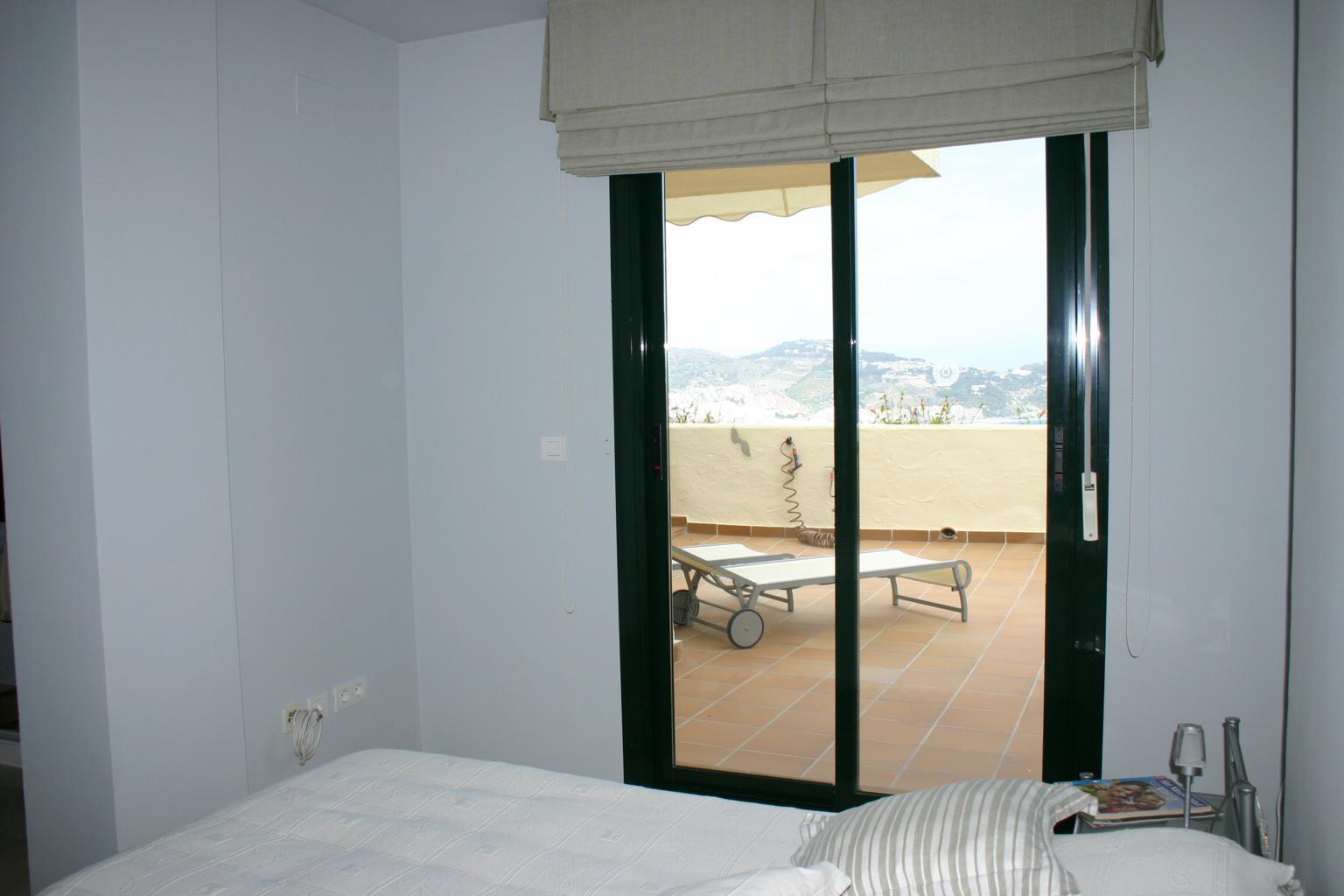Elegant townhouse on the edge of cerro gordo in la herradura las espanas properties Master bedroom with terrace